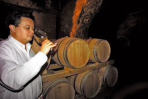 Fabrizio Santarelli samples wine in the Castel de Paolis cellar, Grottaferrata.