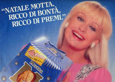 Italian television personality Raffaella Carrà in a 1980s magazine ad for Motta Panettone.