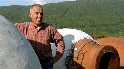 "Josko Gravner poses with his giant amphorae (""anfora"" in Italian) which he has imported by truck from the former Soviet state of Georgia."
