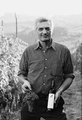 Langhe winemaker Marziono Abbona in his vineyard. All of his wines feature birds on their labels.