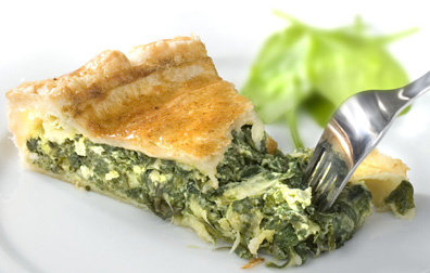 Erbazzone, a spinach and cheese filled pie is a typical dish of Reggio Emilia.