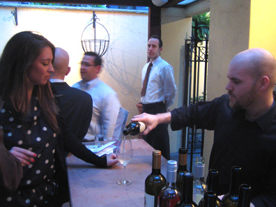 The appropriately-named Ben Spring of Enoteca I Trulli pours Castel Sallegg's Pinot Bianco for a party guest.